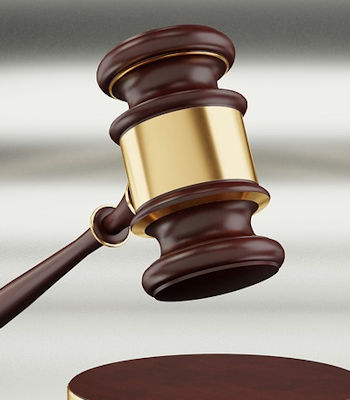 Gavel which represents the justice system and the necessity of hiring a litigation attorney.